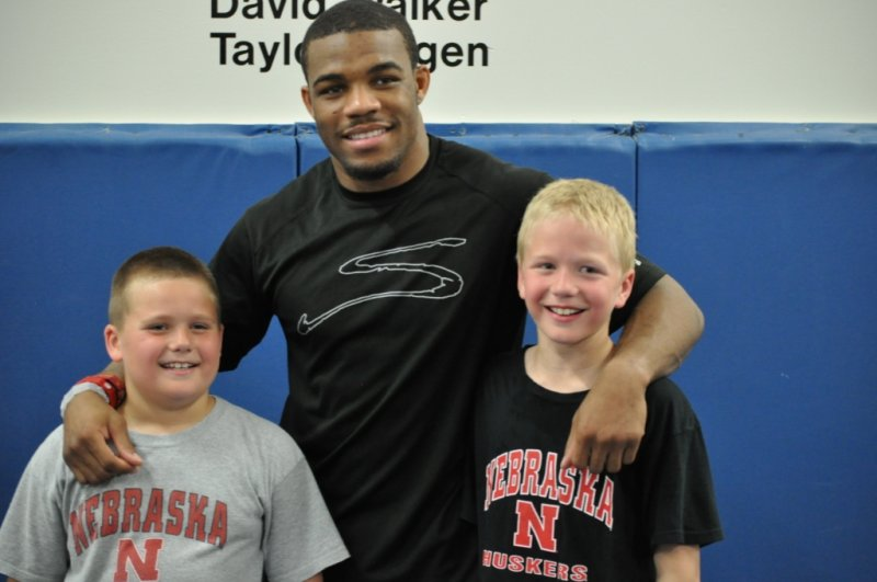 2011 World Champion Jordan Burroughs posing with Runyon Brothers